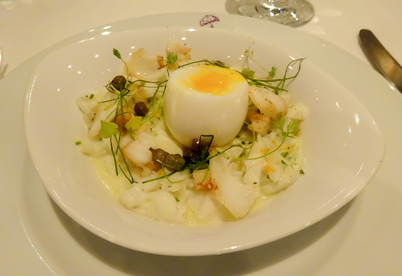 Sea Bass salad with capers, chess, croutons and boiled egg
