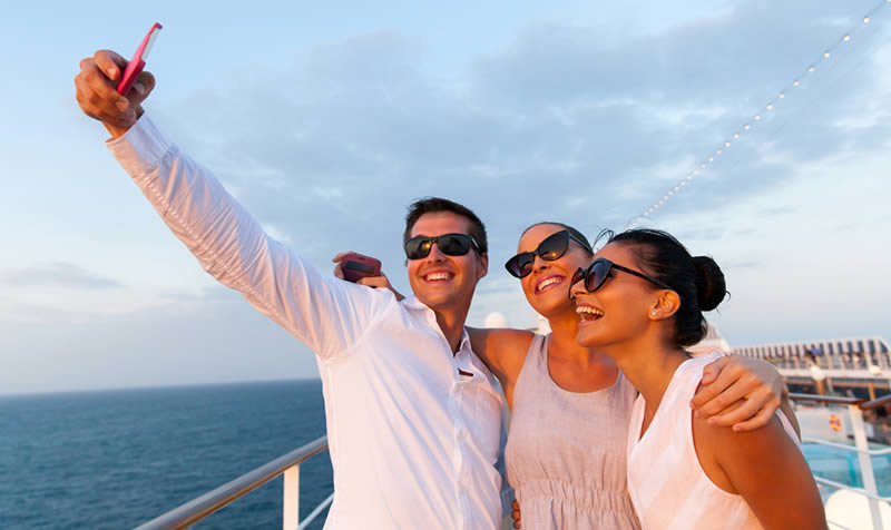 people taking selfies on a cruiseship