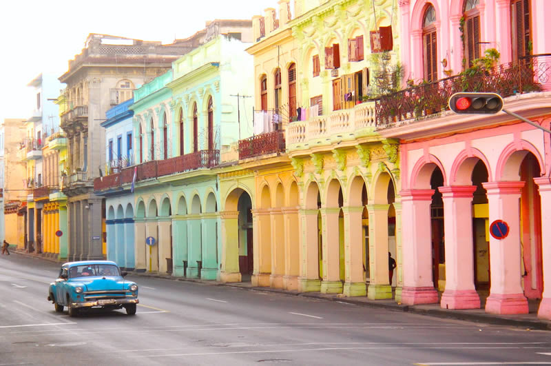 Havana colorful houses and old car