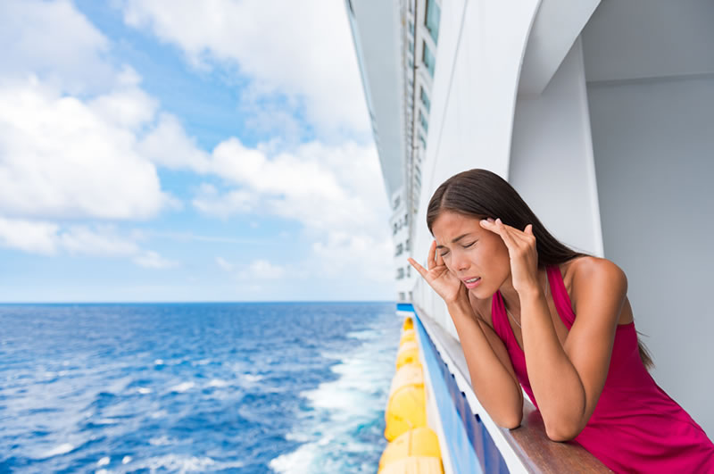 woman suffering from motion sickness on a cruise ship