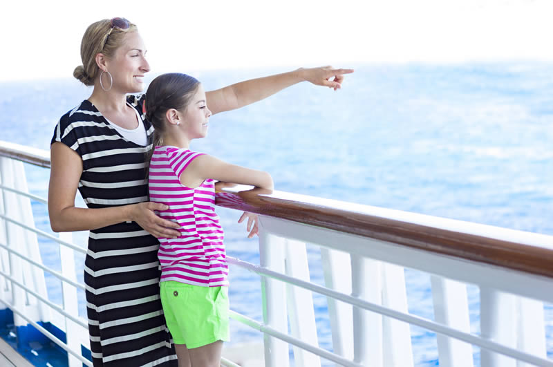 Woman with child on cruise ship deck