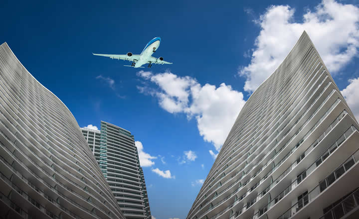 Skyscrapers and airplane landing