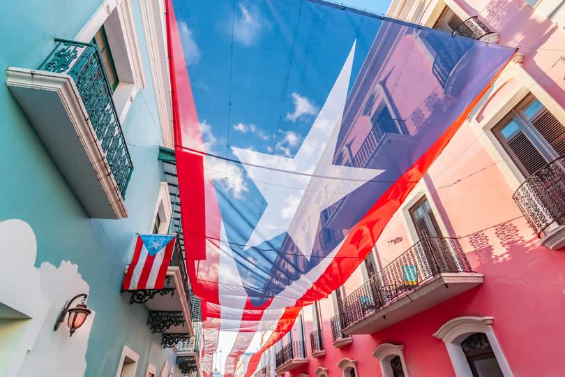 Old San Juan street with national flag