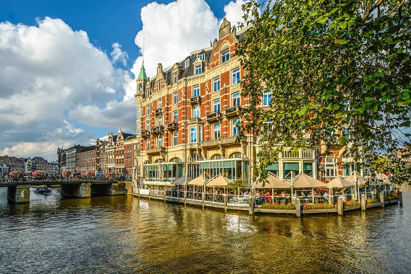 Amsterdam canal and luxury hotel