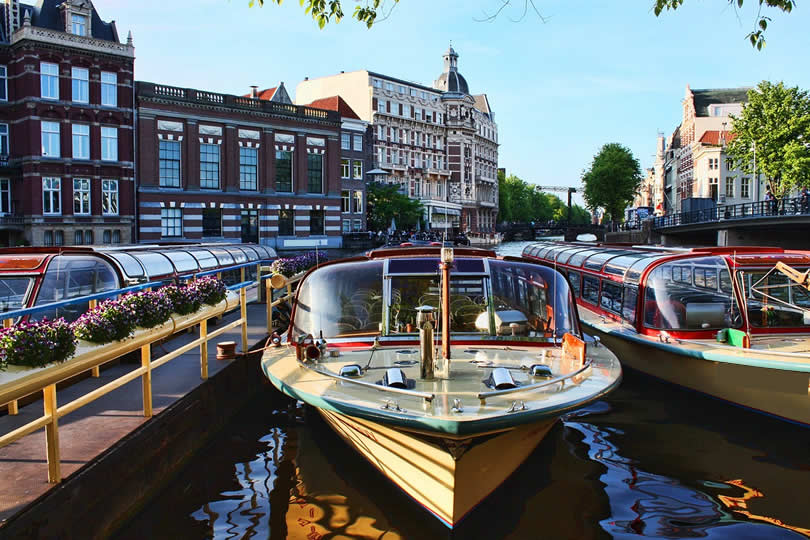 Boats for sightseeing canal tour in Amsterdam